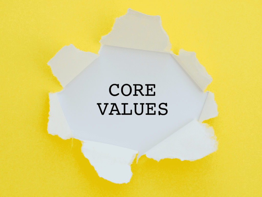 Core Values text breaking through a yellow page